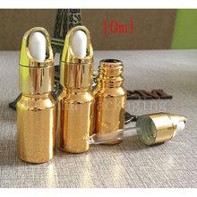 Gold essential oil glass bottles with dropper cap wholesale gold 10ml bottles dropper glass vial cosmetics packaging for sale
