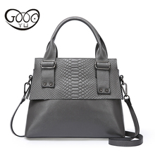 High quality cow leather made of women handbags with embossed serpentine decorative rivets reinforced size medium shoulder bags
