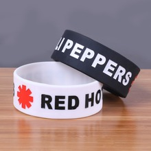 Wholesale 30PCS/LOT silicone bracelets The Red Hot Chili Peppers Cheap Silicone Wristband White and black debossed rubber bangle(China)