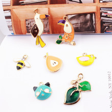 Buy 2017 New 50pcs Alloy Drop oil Cartoon Animals Parrot bee bird green leaf kitten Shape Metal Charms Diy Jewelry Pendant Accessory for $15.12 in AliExpress store