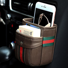 Genuine leather car outlet store box black air conditioner hanging bag creative phone glasses organizer storage bags accessories(China)
