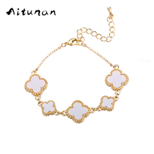Aitunan New fashion Golden Color Four-Leaf Clover Bracelets Bangle for Women Bracelet Jewelry White Classic Romantic Bracelets(China)