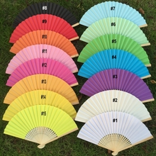 Free shipping 20pcs/lot Solid color Wedding Paper Fan Hand Held Paper Folding Fan in White Gift Bag With 15 colors available(China)