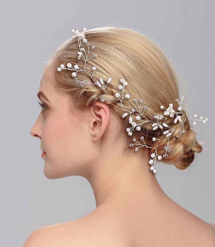 Pikk juukseehe valgete pärlitega