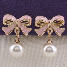 Grace Jun(TM) 2017 New Design Enamel Bowknot Shape Clip on Earrings Without Piercing for Girls Simulated Pearl No Hole Ear Clip(China)