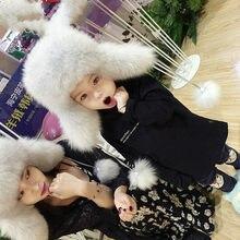 Nuevo sombrero de piel de Rusia invierno Niño niña mujeres hombres piel de zorro  Real sombrero padre-niño niños orejeras cálido . 5a413118f97