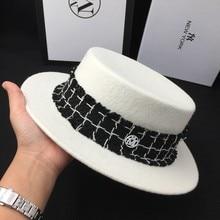 Nueva joker lana techo ala plana sombrero blanco sombrero de moda sombrero  de fieltro sombrero fpr mujeres y hombres sombreros d. 95cb39954b7