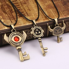 HSIC 10PCS/LOT Wholesale Anime The Legend of Zelda Figure Necklace Red Crystal Gold Pendant Necklace Unisex Cartoon Jewelry(China)