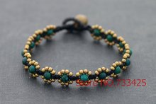 synthetic fynchenite Daisy Bracelet  handmade woven with wax cord and thai style brass bell closure bracelet for women