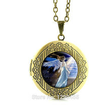 Wholesale Halloween Exquisite jewelry Light of hope Angel Pendant Necklace The dove of peace locket pendant Necklace N141(China)
