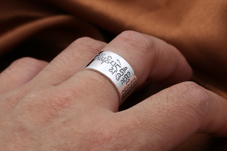 Religious Solid 999 Sterling Silver Sanskrit Buddhist Mantra Rings in hand