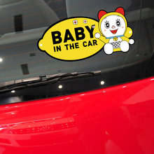 Aliauto Baby In The Car Accessories Cute car And Decal Doraemon decoration For volkswagen polo golf ford focus mazda opel kia(China)
