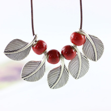 12 Pieces/Lot Women Necklace Jewlery Ceramics Red Color Beads Pendant Long Braided Chain Leaves Pendants Charm Statement Choker(China)