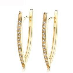 Женские золотистые серьги-кольца с фианитами геометрической формы