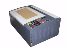 Factory price CO2 Laser engraving machine 3040 with 50W laser tube, honey comb and Rotary axis