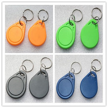 (50 pcs/lot) NFC NTAG215 Tags key fob Token RFID Card 13.56MHz Keychain for All NFC Mobile Phone TagMo Switch