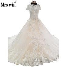 Wedding Dress 2018 The High-end Short Sleeve Elegant O-neck Luxury Lace Embroidery Sweep Train Bling Bling Noble Ball Gown F(China)
