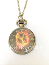 Hot wholesale 10pcs/lot vintage charm movie jewelry Laugh at the bird The Hunger Games pocket watch necklace 2014(China)