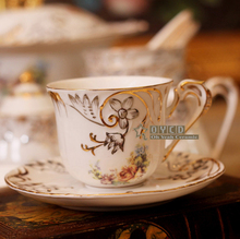 Porcelain tea cup and saucer bone china flowers design embossed handpainted outline in gold coffee cup set tea cup saucer(China)