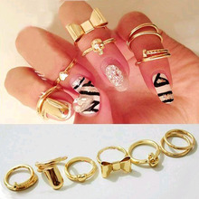 TOMTOSH 2016 New 7Pcs Punk Promotion Gold Color Skull Bowknot Heart Nail Simple Band Mid Finger Top Stacking Rings Set for Women