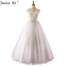 White Sexy Sleeveless Lace Up Wedding Dresses 2017 Real Picture O-Neck Tulle Bridal Gown Vestido De Noiva(China)