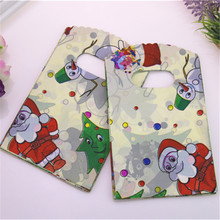 Hot Sale New Design Wholesale 50pcs/lot 9*15cm Good Quality Small Santa Claus Gift Bags Mini Christmas Packaging Bags