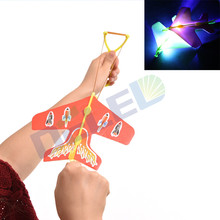 1pcs Stretch Flash Arrows Aircraft Catapult Flying Toys Helicopter Led Light Kids Light UP Toys Color For Random
