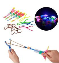 50pcs Luminous Flash slingshot Ufo Free Shipping Elastic Toy Gift Flash Rotating Flying Arrow Rocket Helicopter LED Light(China)