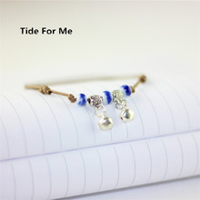 2017 new trendy jewelry porcelain adjustable bell bracelet handmade ceramic bracelet for women blue beaded bracelets with charm(China)