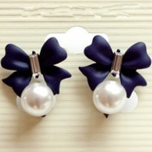Korean version of the new imitation  inlay wild sweet cute bow pearl earrings wholesale
