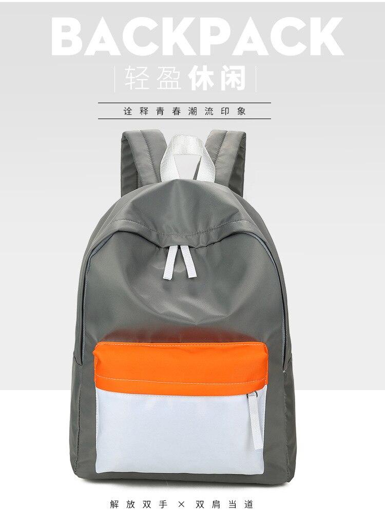 Lihtne hall, sinine või roheline seljakott