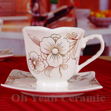Porcelain coffee cup and saucer flower design embossed outline in gold bone china cups and saucers european tea cup and saucer