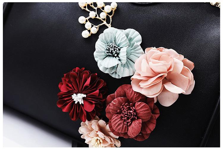 3D lillede aplikatsiooniga nahast käekott