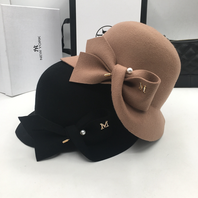Nuevo cubo CUENCA DE bowknot perla de lana sombrero caliente de moda  sombrero de pescador joker 3518371524e