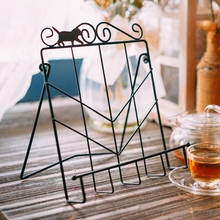 The newspaper magazine rack frame the menu holder metal cat decoration cake book holder(China)