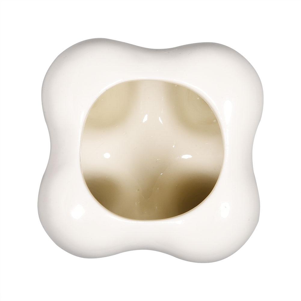Keraamiline hambakujuline lillepott