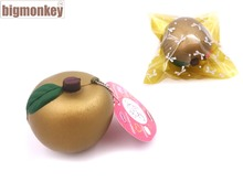 Big monkey 20PCS/LOT PU 7cm golden fruit squishy charm super slow rising / PU  phone strap / including the tag Wholesale