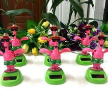 Wholesale Price 12 Pieces Per Lot Dancing Under Full Light Novelty Home&Car Decoration Toys Rocking Solar Crane Style Dolls(China)