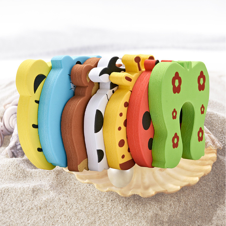 https://monkeypiggy.com/collections/home/products/safety-door-stopper-7-pcs-animals 3