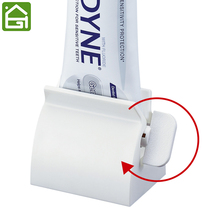 Rolling Toothpaste Tube Squeezer Toothpaste Cosmetic Seat Dispenser Holder Stand(China)