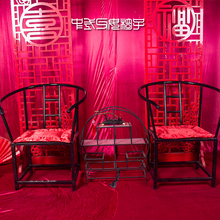 The new Chinese style wedding props iron black background table coverings red wedding hall seat cushions to send parents there