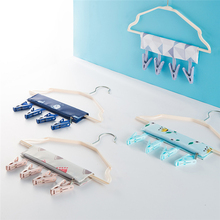 Tenske folding clothes rack Magic 2017 Creative Portable Candy Color Clothes Hanger Anti Skid Universal Rack Home or Travel*30(China)