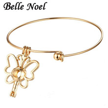 Belle Noel 10pcs/lot Butterfly Hollow Out Pendant Aromatherapy Oil Charm Bracelet Perfume Diffuser Bangles(China)