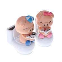 1pcs Solar Powered Bobble Head Pig Sitting On Toilet Home Car Ornament Blue Cute Solar Toys Kids Toy(China)