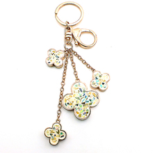 Buy JINGLANG Fashion Keychains Gold Color Metal Keyring Dangle Clover Charms Keychains Handbag Luxury Women Jewelry for $6.19 in AliExpress store