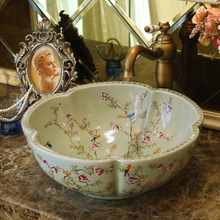 China Artistic Europe Style Counter Top porcelain wash basin bathroom sinks ceramic art hand wash basin flower and bird
