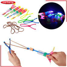 5PCS HOT Funny Glowing Toys LED Flashing Light Flying Toys Arrow Rocket Helicopter Color Light Up Luminous Classic Toys for boys(China)