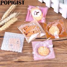 100Pcs/lot 7cm Cute Gifts Bags Christmas Cookie Packaging Self-adhesive Plastic Bags For Biscuits Candy Food Cake Package(China)