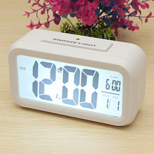 Wholesale 4 Colors Light-sensitive Digital LCD Snooze Alarm Clock With White LED Backlight