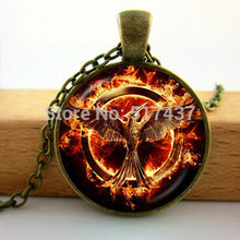 HZ--A111 fly huger games Bird with arrow Pendant fashion fire phoenix pendant dome jewelry cabochons round 25mm HZ1(China)